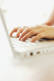 Hands of Woman Using Laptop Computer